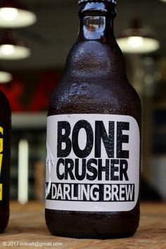 Darling Brew's Bone Crusher: A bottle conditioned frosted Wit Beer with a distinctive candied orange nose. Edgy and refreshing in taste with all the spicy richness and finishes with a lingering bitterness. Coffee Bottle, Beer Bottle, Whiskey Bottle, Beer Industry, Bitterness, Orange Peel, Cold Brew, Craft Beer, Brewery