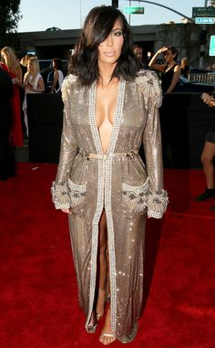 Kim Kardashian kills it on the red carpet in a Jean Paul Gaultier gown with long fringed sleeves. LOVE!