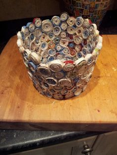 A different shaped pot from recycled holiday magazines.
