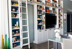 Storage for books, photographs and keepsakes. This unit has closed storage underneath to hold electronics and DVDs, while a sliding library ladder allows easy access to things on the top ...