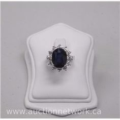 Ladies 18kt White Gold Diamond Custom made Ring with 1 oval faceted cut Sapphire (7.90ct) and 12 rou - Auction Network