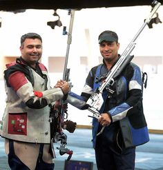Earlier in the day, shooters Sanjeev Rajput (right) and Gagan Narang claimed the silver and bronze, respectively, in the men's 50-metre rifle 3 positions.
