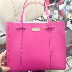 """NEW Kate Spade Small Leather Tote 100% Authentic Kate Spade New York Small Elodie Arbour Hill Leather Tote - Hot Pink Retail store gift receipt included with your purchase!  Small sleek leather tote in Pink Dual flat leather handles with 5"""" drop Removable, adjustable shoulder strap with 20"""" drop Gold tone license plate on front Flat bottom with 4 gold tone feet Interior: fully lined in sleek leather in anthracite Full length zipper pocket along interior rear sideMeasurements: 11"""" w x 9½"""" h x…"""