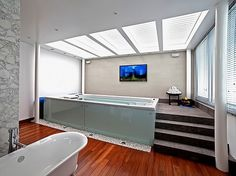 A beautiful indoor Swim Spa installed in a converted garage ...