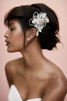 Tuck a crystal comb into your effortless chignon. Visit davidsbridal.com for a whole collection of hair accessories that take any look up a notch.