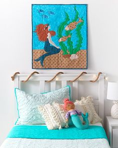 Create a whimsical Mermaid wall hanging with applique. Instructions include template for appliques. #mermaid #kidsdecor #beachdecor #sewing #quilting #applique #coatsandclark