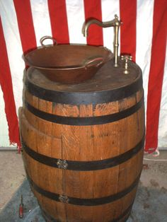 whiskey barrel sink This would be cool at a ranch house
