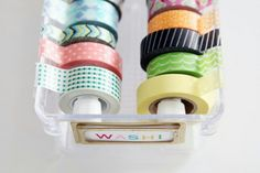 Washi tape storage. Using small tension rods. Would have never thought of that.