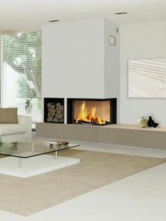 The model: The corner fireplace is glazed and open on three of its faces …. The model: The corner fireplace Fireplace Tv Wall, Fireplace Bookshelves, Stove Fireplace, Modern Fireplace, Fireplace Design, Fireplace Mantels, Fireplaces, Inset Fireplace, Living Room Decor