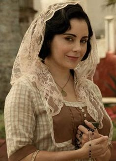 """Veil - mantilla. The veil only """"works"""" if you are wearing an appropriate dress/skirt-blouse.  Otherwise, pants and a veil...a contradiction to be sure!"""