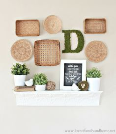 Spring Mantel Decorating Ideas...love the hanging baskets on the wall, as well as the Scripture written on the chalkboard...the real reason of this season too!