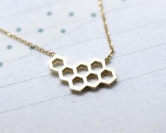 Check out this item in my Etsy shop https://www.etsy.com/listing/215855172/beautiful-honeycomb-necklace-honey