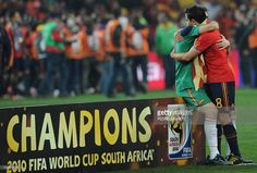 Spain's goalkeeper Iker Casillas and Spain's midfielder Xavi embrace after they won their 2010 FIFA football World Cup final against the Netherlands on July 11, 2010 at Soccer City stadium in Soweto, suburban Johannesburg. Spain won the match 1-0. NO