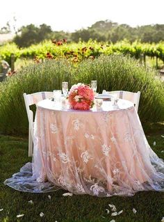 The head table at an outdoor shabby chic romantic wedding