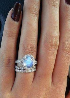 Moonstone ring on finger