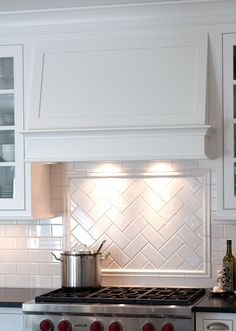 Gorgeous simple hood, and herringbone pattern title backsplash - by Mullet Cabinet