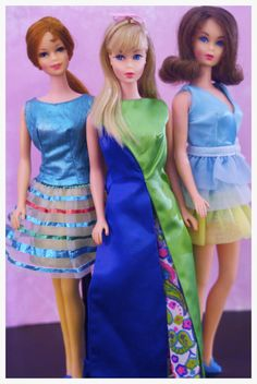 "https://flic.kr/p/nFsyVq | Twist n' Turn Barbies and Stacey | Titian Stacey is wearing ""Twinkle Togs"", Blonde Barbie is wearing ""Patio Party"" and Marlo Flip Barbie is wearing ""Dreamy Blues"""