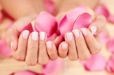 Banish yellowish nails stained from months of wearing dark polish! Combine 1 T peroxide and 2.5 T baking soda to create a paste. Put the paste on your nails and let sit for 5 minutes, then rinse off for healthier, whiter nails!