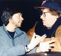 Not having a time machine means we're forced to imagine what documentary film powerhouses Ken Burns and Michael Moore might have been discussing in this photo from the 1998 #Sundance Film Festival.  Ken Burns first came to the Festival in 1986 with Huey Long, while Michael Moore debuted his directorial style with 1990's Roger and Me.  Photo by Jill Orschel