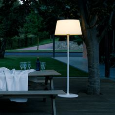 If you're all about sharing a meal with your family in the warm evening air, bring the inside outside with this quirky but cosy Vibia Plis exterior floor lamp.