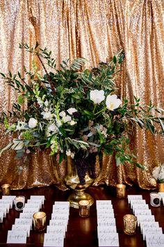 sequin backdrop, photo by Victoria Sprung Photography http://ruffledblog.com/glam-chicago-wedding-with-art-deco-details #seatingchart #weddingideas #escortcards