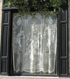 Belgian lace hanging in a Brussels window - Belgian lace is still my very favorite.