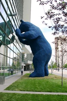 """I See What You Mean"" by Lawrence Argent the big blue bear that peers into the front of our building."
