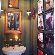 Love these vintage Vogue Magazine covers framed in Charlotte Moss' powder room.