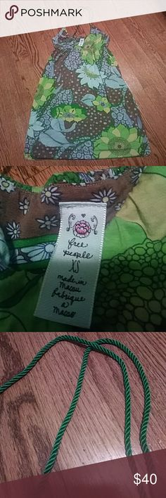 Free People dress Cute floral green teal and brown super soft halter top dress. Xs and stretchy.  Bought new well taken care of. Very fun and girly! Gently used condition great shape. Unique solid green shiny rope around neck for straps. Free People Dresses Mini