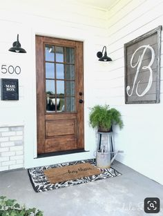 How I made our metal door look like wood – Lyndale Drive – farmhouse front door with screen Front Door Porch, Wood Front Doors, Front Door Colors, The Doors, Front Door Decor, Entrance Doors, Front Door Lighting, Country Front Door, Front French Doors