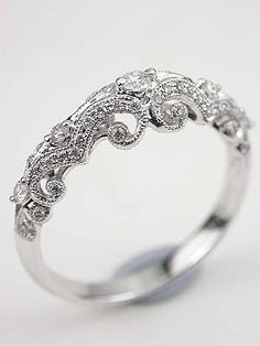 I love the delicacy of this ring. I wish the filigree detail continued all around the band and the stones were a different color, or the band were a different material to provide some color contrast. A pearl would be gorgeous. I do like the size of the stone, though. It's perfect...not too big but still giving the ring a focal point.