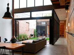 NC office space..  industrial comfortable...  exposed brick, black trim and stained concrete, lots of natural light.  I would like to see a little more life or fun color...