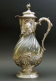 "Koch & Bergfeld, 1890 Germany - Although glass was used for drinking vessels since the earliest times, only the century saw the development of the ""Claret Jug"". Silversmiths began ""modifying"" glass decanters used in the c Argent Antique, Antique Silver, Bottles And Jars, Perfume Bottles, Cles Antiques, Art Nouveau, Antique Glassware, Silver Teapot, Carafe"