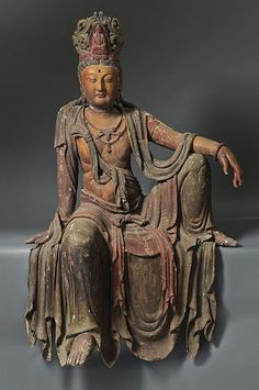 A seated Bodhisattva Guanyin , China , Ming dynasty , 1367-1644.: Ming