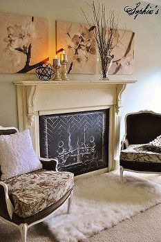 Sitting area idea - with a gas fireplace (not a chalkboard one!), hide rug or sheep skin rug, sconces on either side of the fire place, 2 cozy chairs,   cozy master bedroom retreat, bedroom ideas, fireplaces mantels, home decor