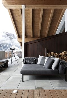 I'm loving this modern rustic Swiss ski chalet with it's mix of old and new wood and emphasis on textures and materials designed by Marcel Wolterinck.