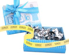 A blue coloured box with 10 assorted chocolates. BABY print on top gives a the box a very chic look. Birthday Chocolates, Print Box, Baby Prints, Baby Blue, Printed, Prints, Kids Prints
