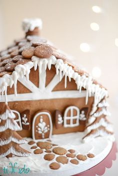 A thorough gingerbread house tutorial by guest poster and gingerbread house pro Nikki of Tikkido!