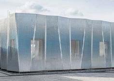 Perforated metal sheets concertina across the facade of an office extension in Lund - johan sundberg arkitektur and blasberg andreasson arkitekter Metal Design, Facade Design, Exterior Design, Perforated Metal Panel, Metal Panels, Most Visited National Parks, Metal Facade, Warehouse Design, Modern Entrance