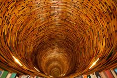 Infinite Tunnel of Books in Prague library- The photo presents a pretty seamless perspective — you can't really tell where the mirror is; there's so many books that it's hard to detect where the visual repetition starts. City Library, Prague City, Red Team, Installation Art, Infinite, Book Lovers, Illusions, Decorative Bowls, Museums