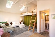 Stick a loft bed where there is a tall ceiling. It provides guest room space (or nap space).