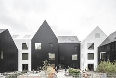 Copenhagen-based COBE Architects designed a kindergarten modeled on simple children's drawings of houses with peaked roofs.