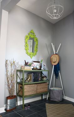 Metal shelf, painted, with baskets Sarah & Brian's Salvaged Stories House Tour | Apartment Therapy