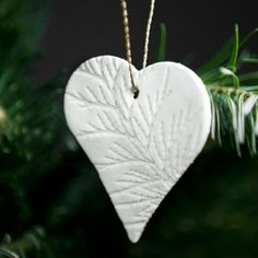 DIY Christmas Ornaments made with white clay. Use them to decorate the gifts or hang them on the tree.