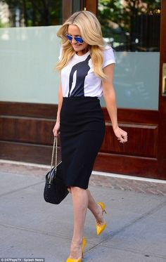 Kate Hudson in Christian Louboutin 'Iriza' heels and a Chanel bag in New York.