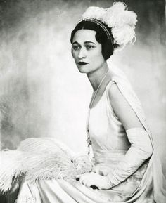 Wallace Simpson.  A king abdicated his throne for her.  (King Edward VIII, uncle of Elizabeth II.)  She and Edward who became Duke and Duchess of Windsor, married but never had children.