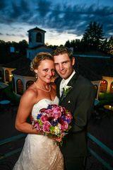 bride and groom posing on the balcony at Perona Farms
