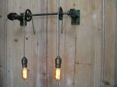 light fixtures made from factory pulleys $1,400  Big Daddy's Antiques, 3334 S.La Cienega Place, LA