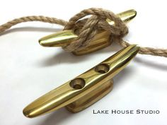 ONE Authentic Solid Brass Dock Cleats, Nautical Door Handle, Nautical Drawer Pulls, Golden Boat Cleat, Nautical Towel Hook by LakeHouseStudio on Etsy https://www.etsy.com/listing/206432844/one-authentic-solid-brass-dock-cleats