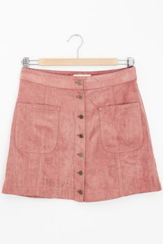 """- Details - Size - Shipping - • 100% Polyester • Faux suede skirt with fully functional buttons and pockets • Dry clean • Imported • Measured from small • Length 15"""" • Waist 13.5"""" - Free domestic ship"""